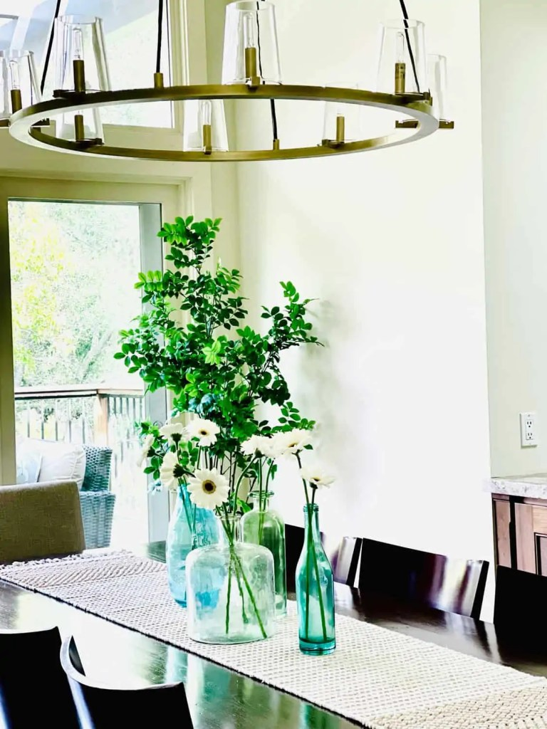 Dining Room with turquoise vases