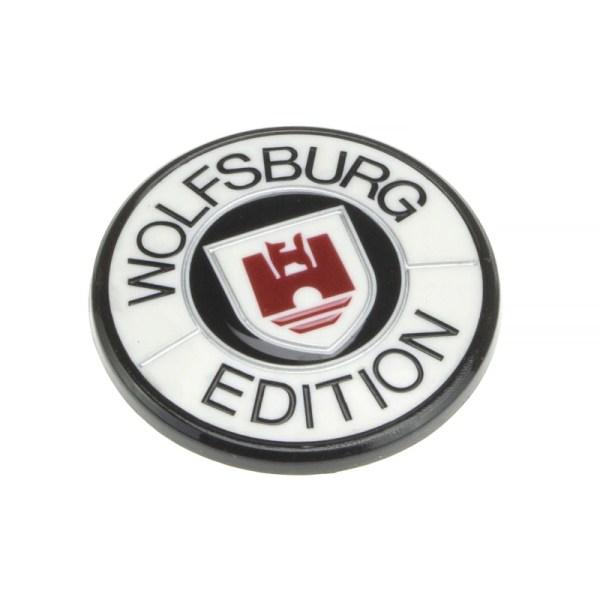010802019W Emblemat Wolfsburg Edition (Biały) VW Golf 1/2