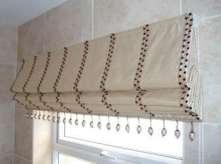 Roman Blind and Eyelet Curtains