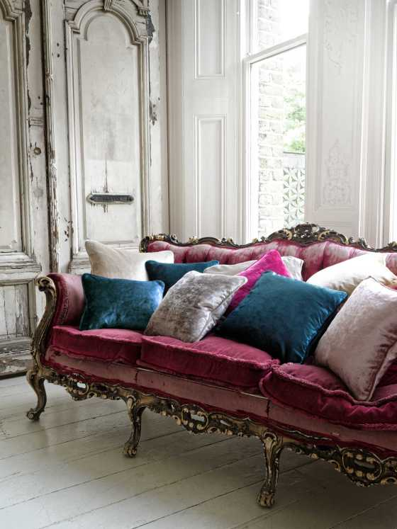 "alt=""photo of an antique sofa and cusions made with Clarke & Clarke Allure velvet fabric"""