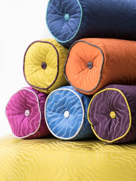 "alt=""cushions made of bright coloured fabric from the Clarke & Clarke Fuji Collection"""