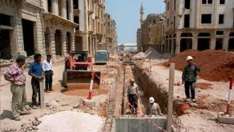 Workers are laying new pipes in war-devastated dow