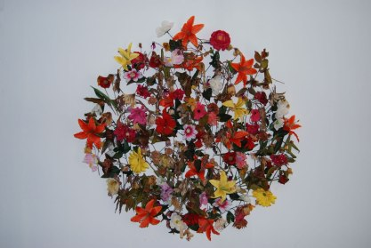 "Sham, 2010. Artificial and real flowers. 64"" diameter"