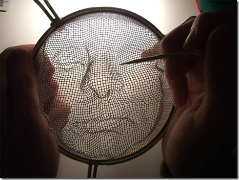strainer-shadow-faces-made-from-colanders-isaac-cordal-8