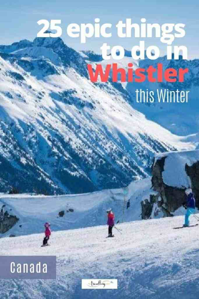 skiers on slopes of whistler in winter