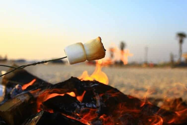 smores over beach fire in southern california