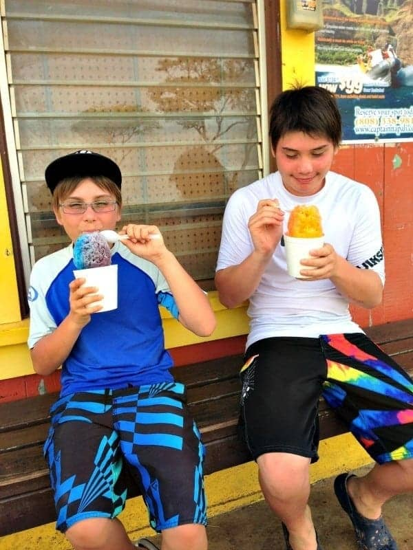 two boys eating shave ice