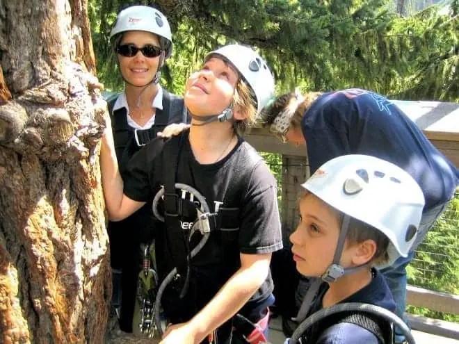 mom and kids ready to zipline with Ziptrek Whistler