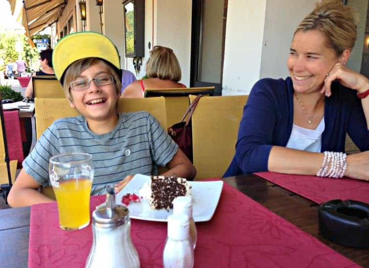 mother and son laugh over cake in germany