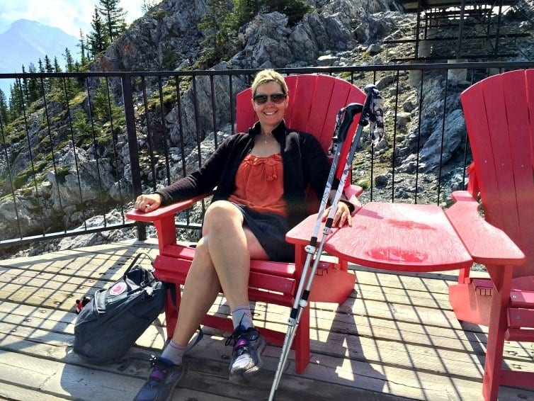 lady seated in parks canada red chair