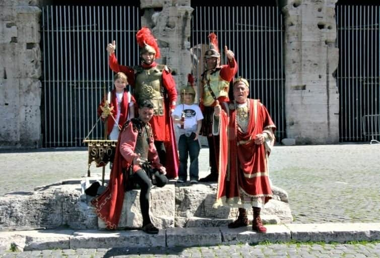 boys posting with roman gladiator actors in rome