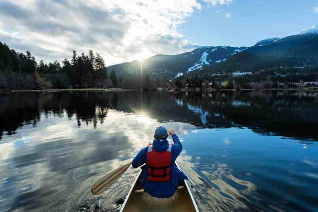 man canoeing on river of golden dreams whistler