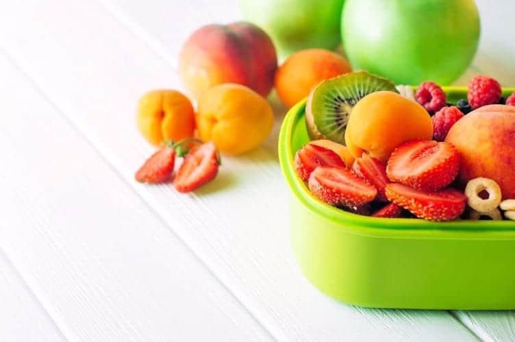 green container with pieces of fruit snacks