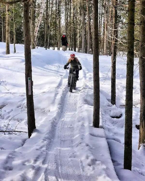 woman on fat bike in winter