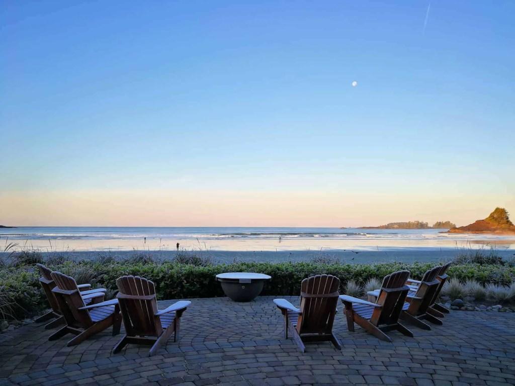 chairs overlooking cox bay beach in tofino