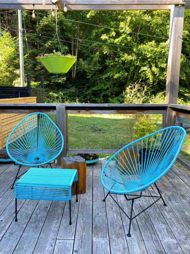 blue patio chairs at woods on pender