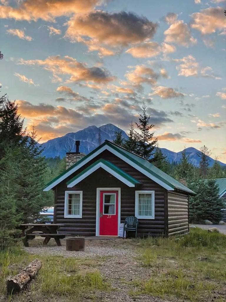log cabin at pine bungalows at sunset