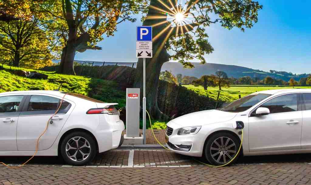 two white electric charges charging