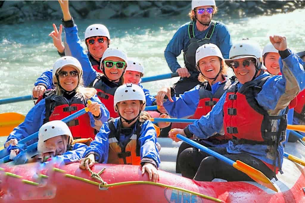 families rafting in revelstoke in summer