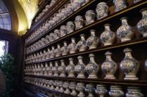Questi sono solo alcuni dei 457 vasi di maiolica custoditi nella farmacia: la fabbricazione è imolese e risale al 1765.