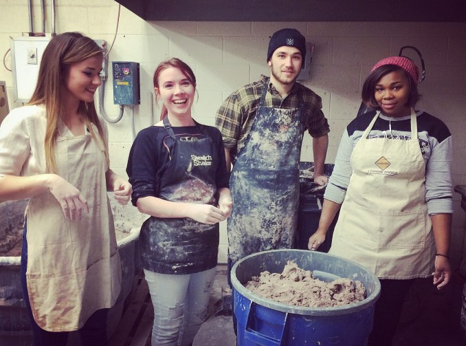 Students filled with joy after mixing their first batch of clay