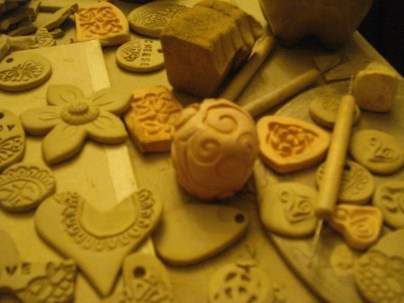 Handmade celtic knots positive and negative, carved swirly ball and trade aid stamp.