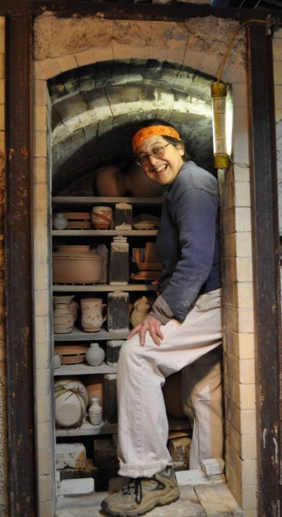 Loren loading her kiln