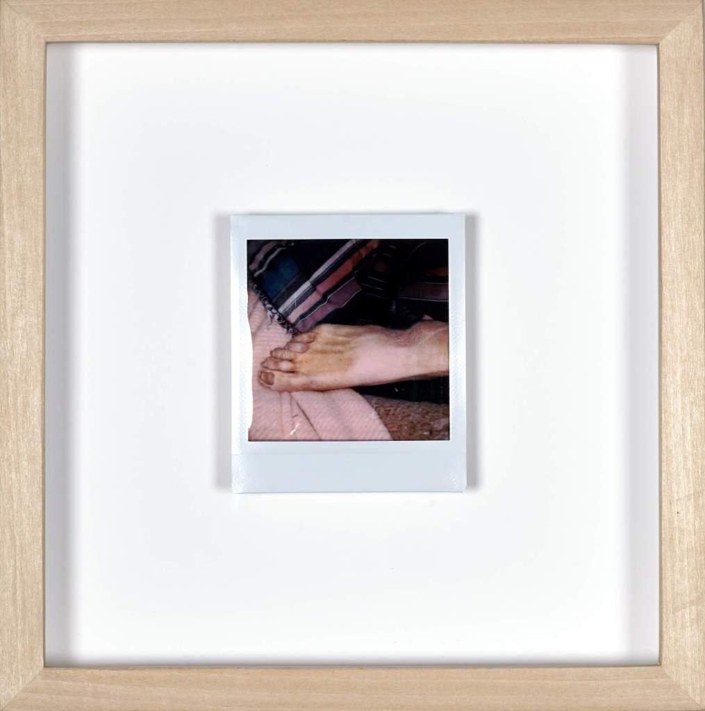 Photo taken by artist Clayton Porter of his father's body—postmortem—framed under glass in maple.