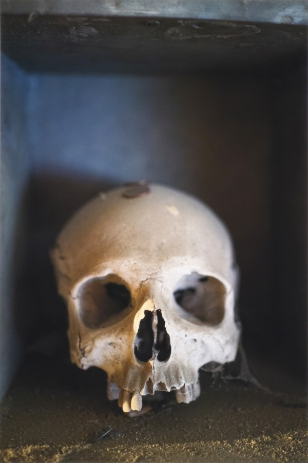 Human skull in its guardian house kept by the anime pezzentelle cult at the Cimitero delle Fontanelle ossuary in Napoli Italy.