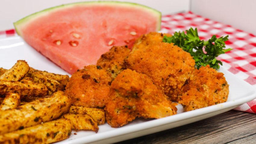 air fryer crispy buffalo cauliflower next to watermelon and yuka fries