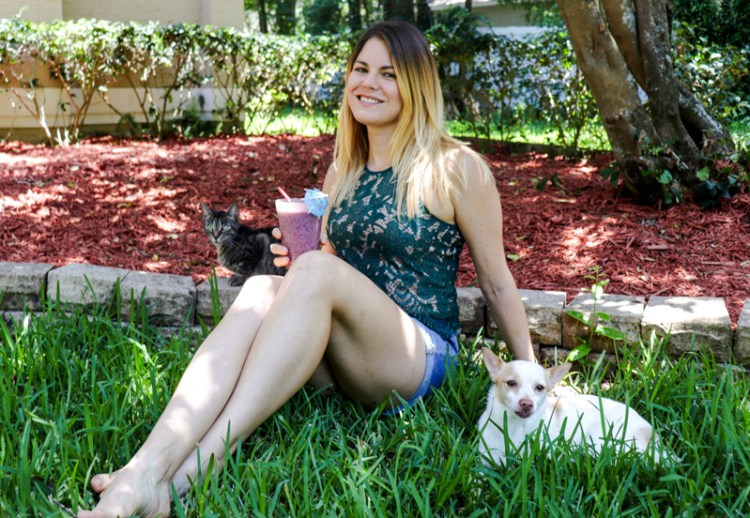 Sipping a kombucha smoothie while hanging out with the cat and dog