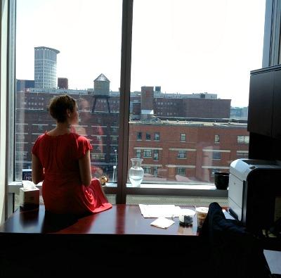 Meg Perched on Office Desk