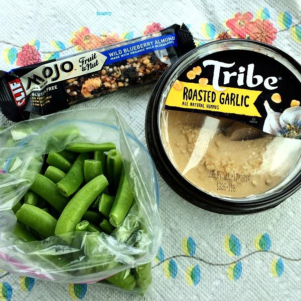 Road Trip Snacks Snap Peas, Hummus, and Clif Bar