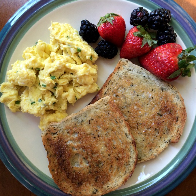Hers Scrambled Eggs with Chives, Rye Bread and Berries