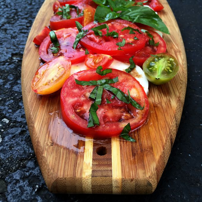 Caprese Salad. This simple summer dish combines sun-ripened tomatoes, tangy mozarrella, and fresh basil for an easy and elegant salad, which comes together in mere minutes. It's as delicious as it is easy to make.