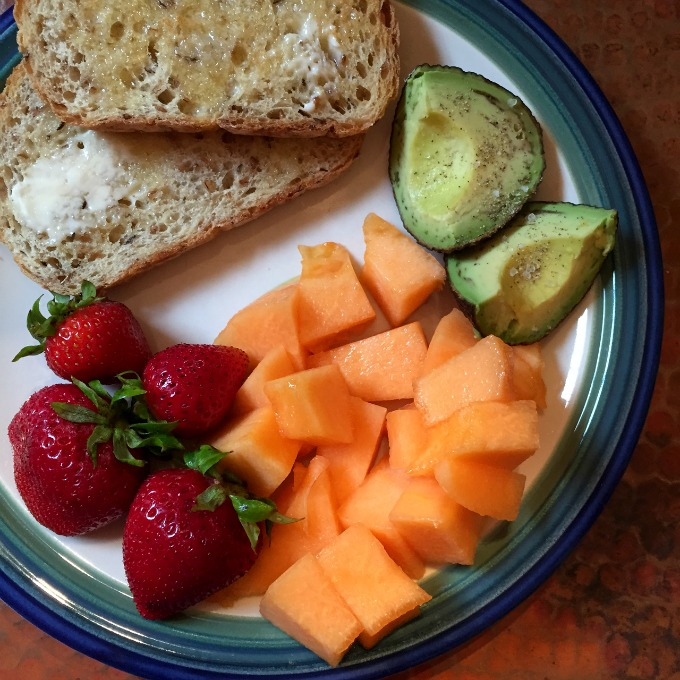 Onion Rye Bread, Avocado, Berries and Canteloupe