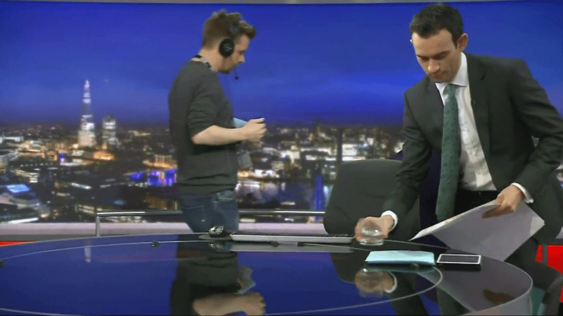 PICTURED: BBC News Channel technical glitch results in presenter changeover being seen on-air. Presenter: Ben Bland.