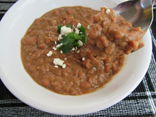 Spoon of Slow Cooker or Instant Pot Refried Beans