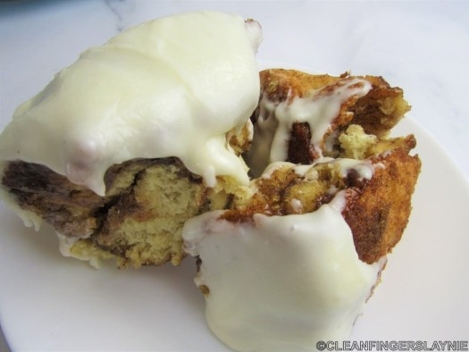 Slow Cooker Monkey Bread with Cream Cheese Frosting on White Plate