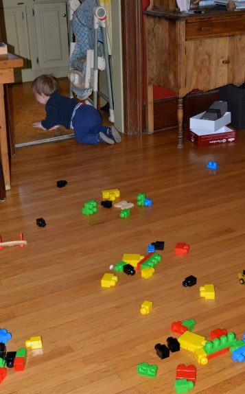 mega blocks and toys all over floor