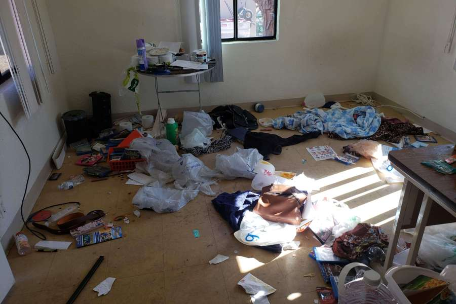 A very soiled room in need of considerable cleaning