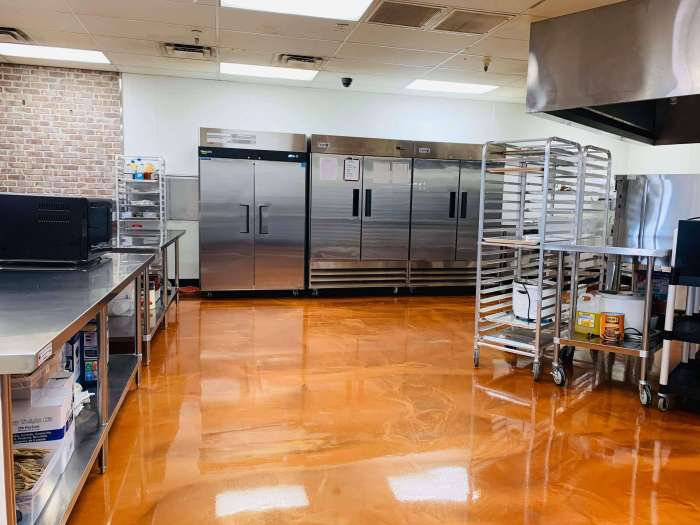 Beautiful shiny orange mopped commercial kitchen floor