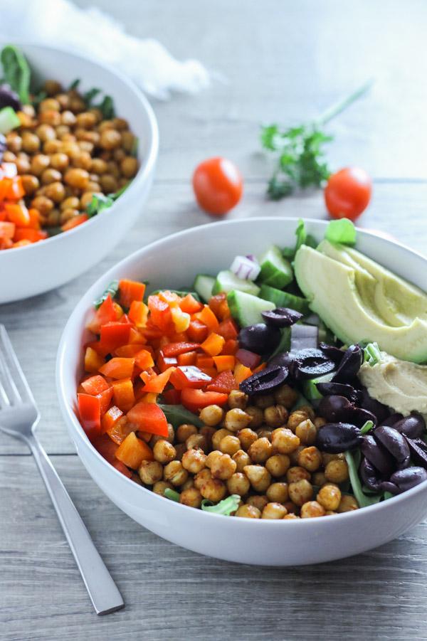 side angle view of 2 greek salad bowls