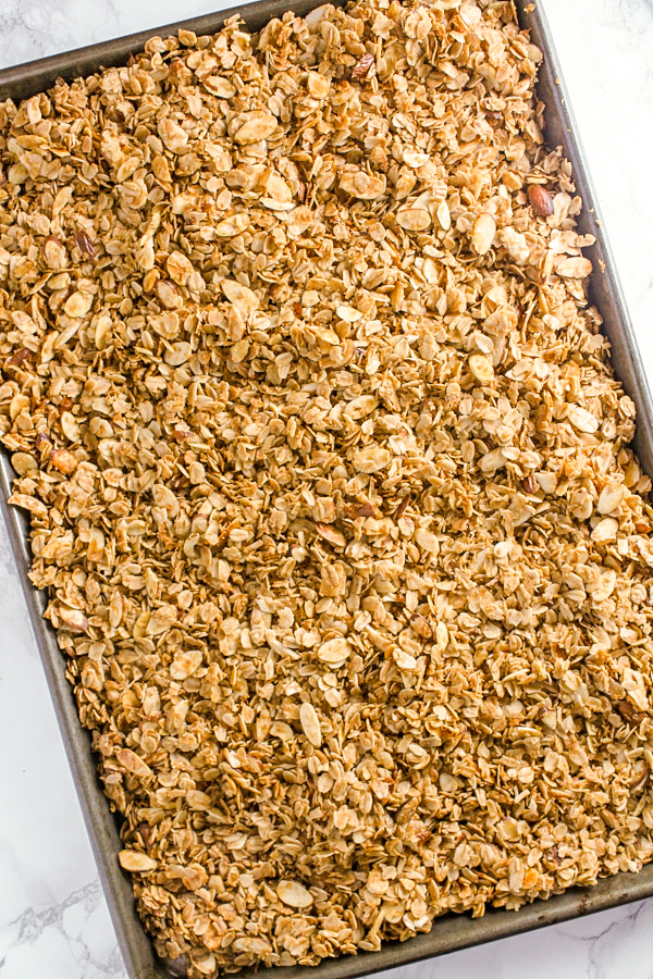 overhead view of honey granola in baking pan