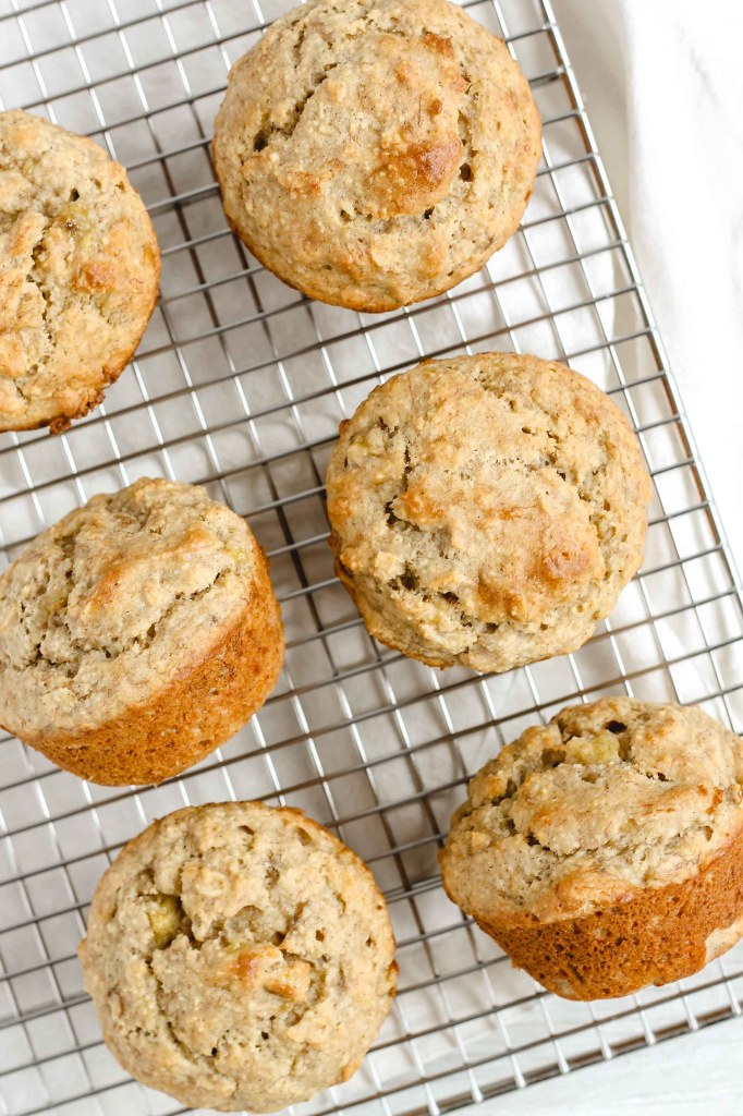 overhead view of banana muffins on wire cooling rack