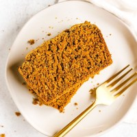 overhead view of sliced pumpkin bread on a white plate