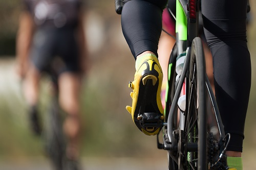 How to Clean Your Peloton Cycling competition cyclist athletes riding a race at high speed, detail of cycling shoes