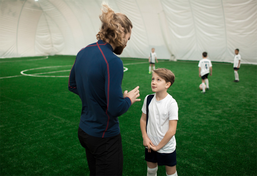 sports equipment disinfectant spray kid talking to trainer