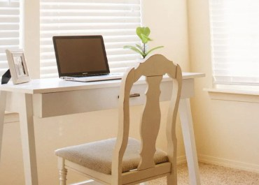 small desk with laptop and plant work from home