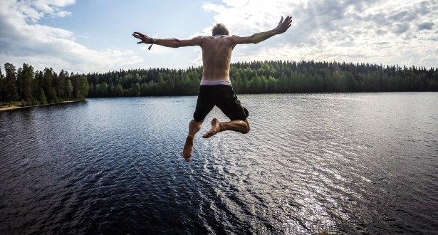 guy jumping into lake